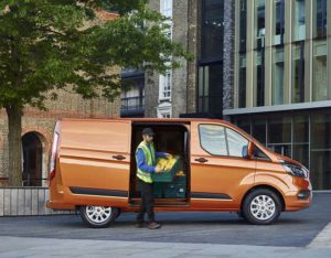 A man using a 181 Ford Transit Custom for work